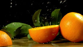 Group of oranges with leaves on wooden boards. stock video footage