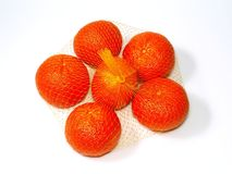 Group of oranges in net bag Royalty Free Stock Images