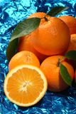 Group of oranges over a blue background. Group of oranges over a metalic blue background Royalty Free Stock Images