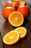 Group of oranges on a table. Group of oranges on a wooden table Royalty Free Stock Images