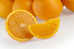 Orange group with a slice and wedge Royalty Free Stock Photography