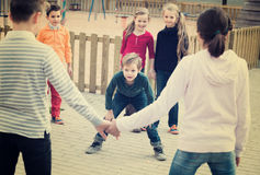 Group of ordinary children playing red rover Royalty Free Stock Photos