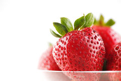 A group of organic fresh strawberries Stock Photos