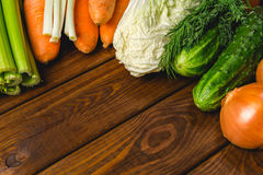 Group of organic vegetables on rustic wooden table. With copy space for text Royalty Free Stock Photography
