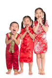 Group of oriental children wishing you a happy Chinese New Year. With traditional Cheongsam full length standing isolated on white background