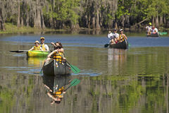 Group of paddlers canoeing on Shingle Creek in Kissimmee, Florid Stock Photo