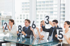 Group of panel judges holding score signs Royalty Free Stock Photography