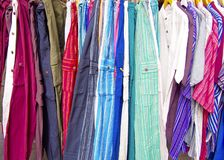 Group of pants and shirts. In the store Royalty Free Stock Image
