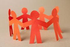 Group of paper chain people Royalty Free Stock Photo