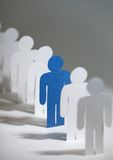 Group of paper men standing in a row Royalty Free Stock Photography