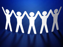Group of paper people holding hands. Stock Photo