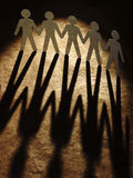Group of paper people holding hands. Royalty Free Stock Image