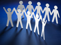 Group of paper people holding hands. Royalty Free Stock Photos