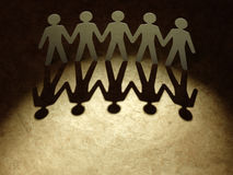 Group of paper people holding hands. Royalty Free Stock Photo