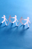 Group of paper people holding hands Royalty Free Stock Photos