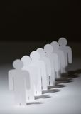 Group of paper people standing in a row Royalty Free Stock Images