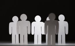 Group of papermen on black background Stock Image