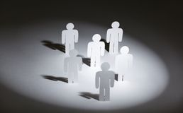 Group of papermen in the light Stock Photos