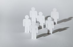 Group of papermen on white background stock photography
