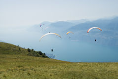 A group of paratroopers on Garda lake. A group of paratroopers on the Garda lake, near Monte baldo, in Italy. Spectacular extreme sports Stock Photography