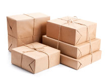 Group of parcel wrapped with brown packing paper Royalty Free Stock Photo