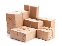 Group of parcel wrapped with brown packing paper Royalty Free Stock Photos