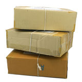 Group of parcels boxes wrapped with brown tape Royalty Free Stock Images