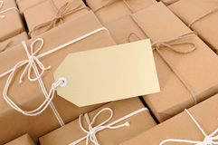 Manila brown label, blank, copy space, with lots of brown paper packages Stock Photos