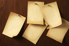 Group of parchments nailed on wooden board Royalty Free Stock Images