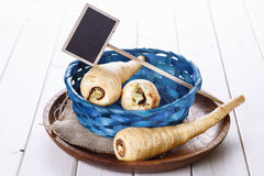 Group of parsnips in a blue woven basket Royalty Free Stock Photos