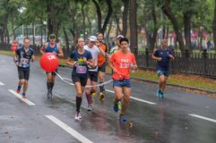 Group of participants following pacemaker during 42 km distance of ATB Dnipro Marathon royalty free stock image