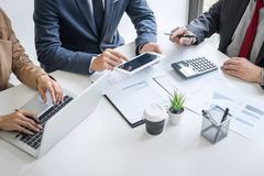 Group of partner working conversation, Business team meeting present with investor colleagues discussing plan financial graph data stock image