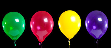 Group of party balloons on black Royalty Free Stock Photo