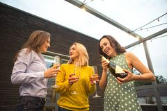 Group of partying girls with flutes with sparkling wine having fun. On the party royalty free stock photo