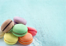 Macaroons on blue textured shabby chic background. Group of pastel color macaroons on blue textured shabby chic background, with room for copy space Royalty Free Stock Photography