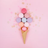Group of pastel colorful macarons on trendy background Royalty Free Stock Images