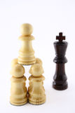 Group of pawns attacking the queen Royalty Free Stock Images