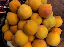 Group of peaches displayed in a market royalty free stock photo