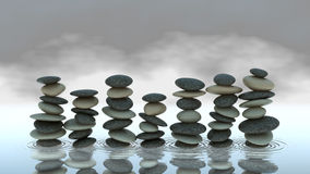 Group of Pebble stacks on water level. Harmony and balance Stock Images