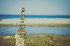 Pebble tower. Group of pebbles in the beach Royalty Free Stock Photos