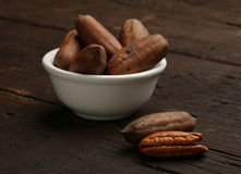 Group of pecan nuts in a bowl Royalty Free Stock Photography