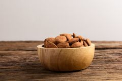 Group of Peeled almonds in wooden bowl Stock Photography