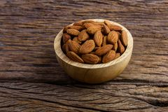 Group of Peeled almonds in wooden bowl Royalty Free Stock Photography