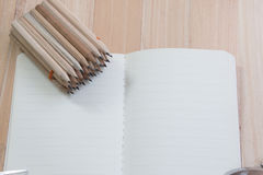 Group of Pencil put on empty notebook Royalty Free Stock Photo