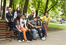 Group of peope on bench in park. Stock Photo