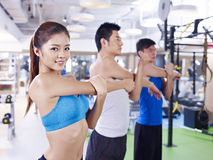 Group of people in aerobics class. Group of people doing aerobics in gym; shallow depth of field, focus on the girl royalty free stock photography