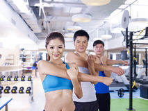 Group of people in aerobics class. Group of people doing aerobics in gym; shallow depth of field, focus on the girl Royalty Free Stock Photo