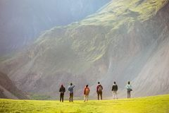 Group of people against mountains valley royalty free stock photography