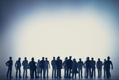Group of people against the white light. Stock Photography