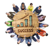 Group of People around Wooden Table with Success Royalty Free Stock Photo
